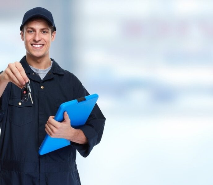 equipment needs for opening an auto shop, auto mechanic holding out keys